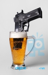 pistol-in-beer-glass-10022828.jpg
